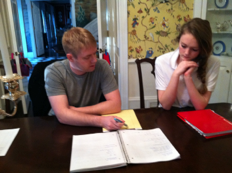 student and tutor working